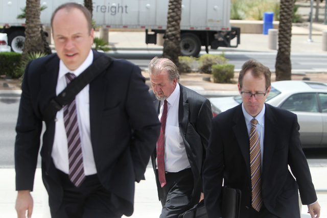 Las Vegas attorney Keith Gregory, center, enters the Lloyd D. George U.S.Courthouse on Wednesday, June 17, 2015, in Las Vegas. Gregory and other defendants were sentenced in the scheme to take ove ...