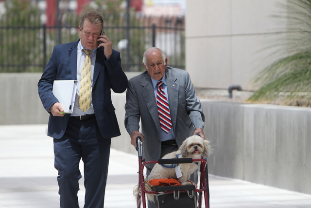 Steve Ruvolo, right, enters the Lloyd D. George U.S. Courthouse on Wednesday, June 17, 2015, in Las Vegas. Gregory and other defendants were sentenced in the scheme to take over and defraud HOAs.  ...
