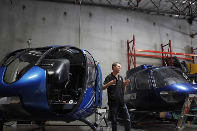 """Doug Scroggins talks about the EC-130, left, which was used in """"Jurassic World"""" on Wednesday, June 17, 2015, in Las Vegas. Scroggins Aviation supplies helicopters for movies such as """"Jurassic Worl ..."""