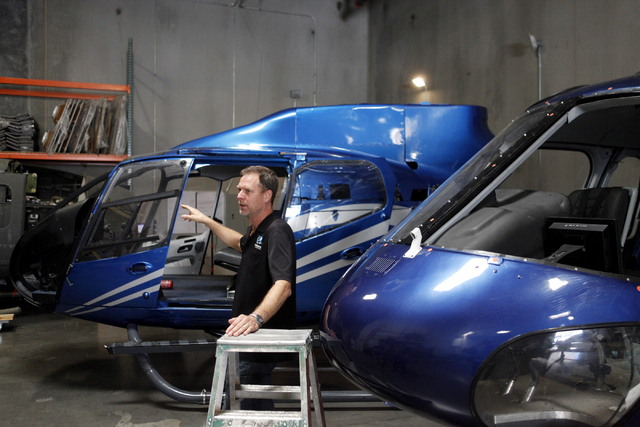 "Doug Scroggins talks about the EC-130, left, which was used in ""Jurassic World"" on Wednesday, June 17, 2015, in Las Vegas. Scroggins Aviation supplies helicopters for movies such as ""Jurassic Worl ..."