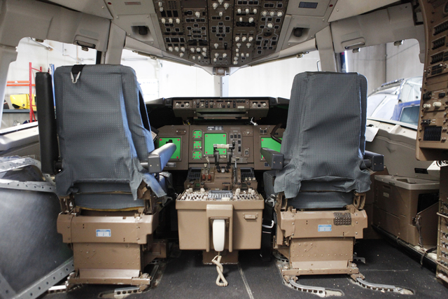 """The inside of a Boeing 767 is seen at Scroggins Aviation on Wednesday, June 17, 2015, in Las Vegas. Scroggins Aviation supplies helicopters for movies such as """"Jurassic World."""" Green patches on th ..."""