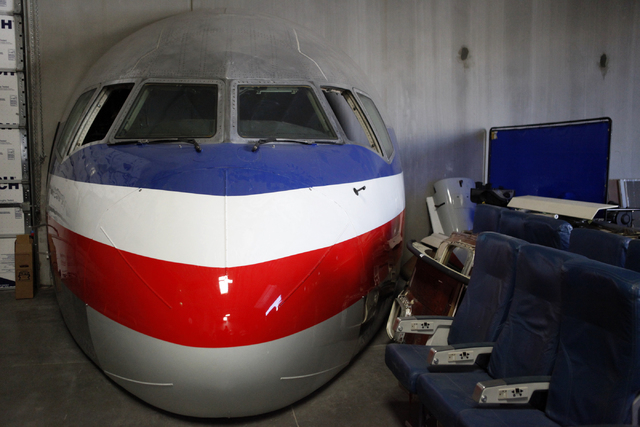 """The front of a Boeing 767 is seen at Scroggins Aviation on Wednesday, June 17, 2015, in Las Vegas. Scroggins Aviation supplies helicopters for movies such as """"Jurassic World."""" (James Tensuan/Las V ..."""