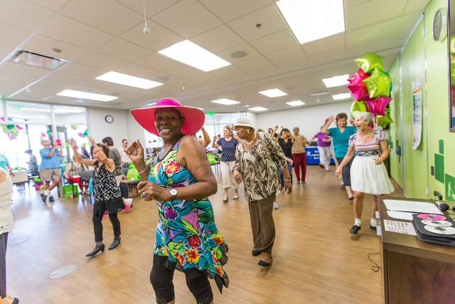 Line dance instructor Edith Nardini, far right, encourages attendees while Ruby Palmer, foregoround, and Mattie Flippen, second from right, follow along. A line dance demonstration was one of the  ...
