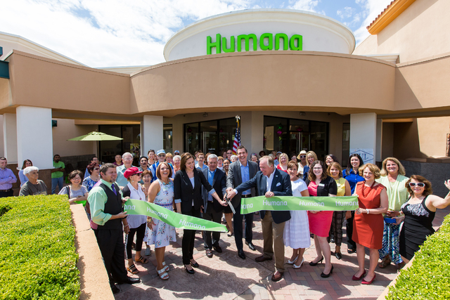 Humana leadership is supported by community residents as they cut the ribbon to reopen the Humana Guidance Center June 10, 2015. The center, 8885 W. Charleston Blvd., Suite 140, moved a few doors  ...