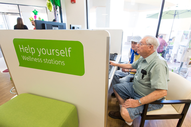 Las Vegas residents Anthony Mottola, left, and Richard Dutton utilize the free computers available to Humana Guidance Center visitors at the grand reopening celebration June 10, 2015. The center o ...