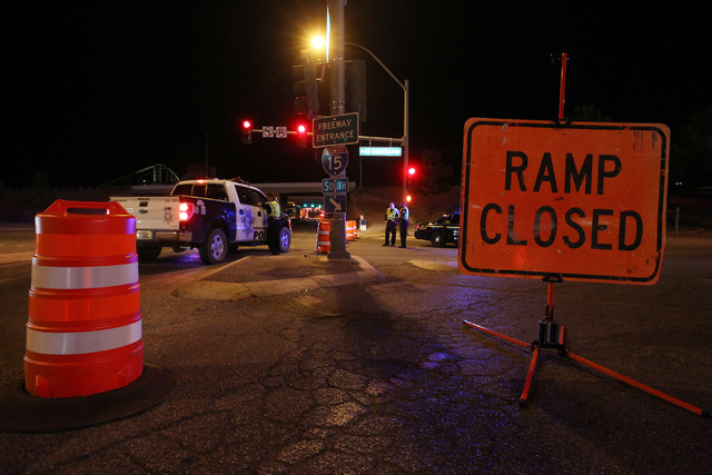 The onramp to southbound Interstate 15 at Primm is closed as workers install a new sign near Yates Well Road south of Primm, Wednesday, June 17, 2015. Southbound traffic was stopped at Primm from  ...