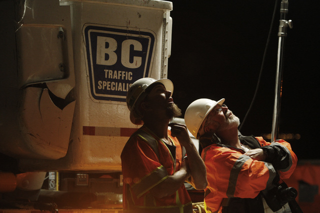Workers from B C Traffic watch as a new sign is dropped into place over Interstate 15 near Yates Well Road south of Primm, Wednesday, June 17, 2015. Southbound traffic was stopped at Primm from 1  ...