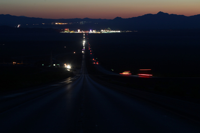 Traffic begins flowing south after a new sign was installed over Interstate 15 near Yates Well Road south of Primm, Wednesday, June 17, 2015. Southbound traffic was stopped at Primm from 1 a.m. to ...
