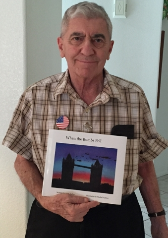 "Henderson resident Jerry Julius stands with his first children's book, ""When the Bombs Fell."" The book describes his personal experiences during the London Blitz in World War II. (Special to View)"