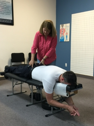 Chiropractor Dr. Brenda L. Hilby works with a patient at the Northwest Wellness Center, 4611 N. Rancho Drive, May 2014. (Special to View)