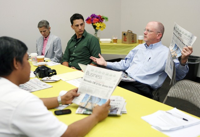 Michael Hengel, right, Las Vegas Review-Journal editor, speaks to Indonesian journalists during a meeting at the Las Vegas Review-Journal Tuesday, June 10, 2014. Sahat Simatupang (cq), from left,  ...