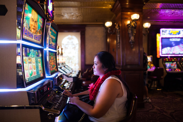 Jennifer Horikawa of Maui, Hawaii, plays on a slot machine at the Main Street Station hotel-casino in downtown Las Vegas on Tuesday, May 26, 2015. The Internal Revenue Service has proposed lowerin ...
