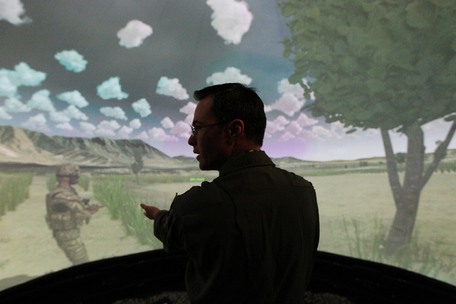 U.S. Air Force Joint Terminal Attack Controller instructor Lt. Col. Matt Williams shows the inside of an Advanced Air National Guard JTAC Training Simulator at Nellis Air Force Base in Las Vegas d ...