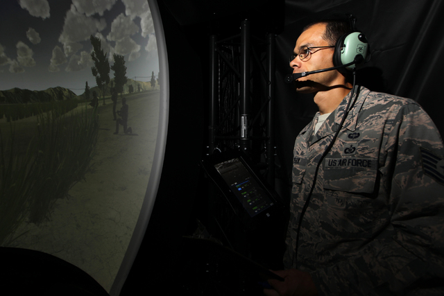 U.S. Air Force Joint Terminal Attack Controller instructor Tech. Sgt. Carlos Pea watches over a demonstration of the Advanced Air National Guard JTAC Training Simulator at Nellis Air Force Base in ...