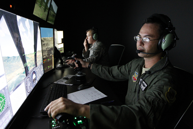 U.S. Air Force Joint terminal attack controller instructors Staff Sgt. Rusty Welch, left, and Lt. Col. Matt Williams demonstrate how to train using an Advanced Air National Guard JTAC Training Sim ...