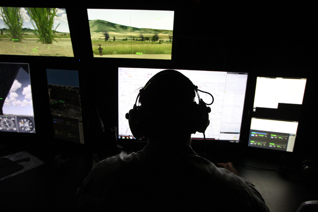 U.S. Air Force Joint Terminal Attack Controller instructor Staff Sgt. Rusty Welch demonstrates how to train using an Advanced Air National Guard JTAC Training Simulator at Nellis Air Force Base in ...