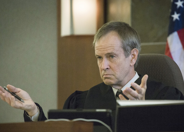 Clark County District Court Judge Erick Johnson queries attorneys during a recall hearing for North Las Vegas Municipal Court Judge Catherine Ramsey at Regional Justice Center, 200 Lewis Avenue. o ...