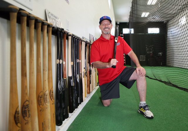 Mike Bryant, father of Chicago Cubs third baseman Kris Bryant, kneels in a home gym with a batting cage Friday, June 5, 2015, in Las Vegas. Bryant is a local hitting instructor and played Double A ...