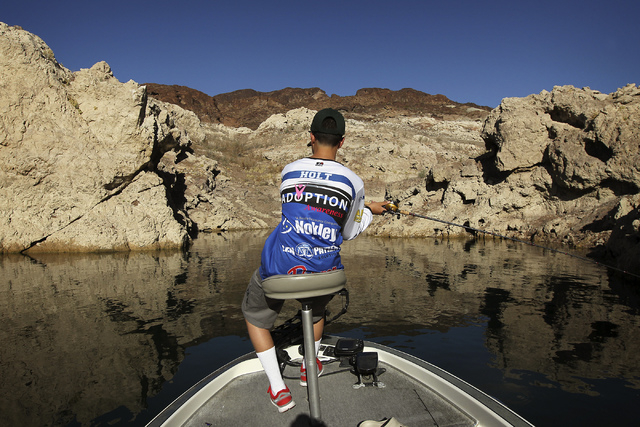 Zach Holt casts his line while fishing on Lake Mead, Aug. 14, 2013. (Jason Bean/Las Vegas Review-Journal)
