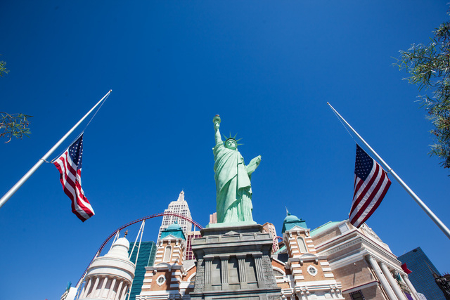 Flags are seen lowered to half-staff in honor of Kirk Kerkorian, one of the founders of modern Las Vegas, outside of the New York-New York hotel-casino in Las Vegas on Tuesday, June 16, 2015. Kerk ...