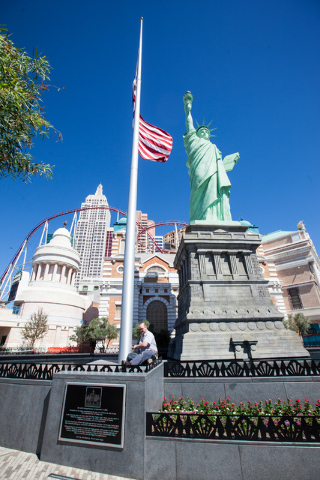 Engineer Randy, last name declined, lowers the flag to half-staff in honor of Kirk Kerkorian, one of the founders of modern Las Vegas, outside of the New York-New York hotel-casino in Las Vegas on ...
