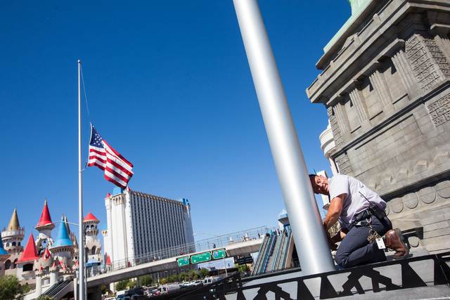 Engineer Dan Loyd adjusts the flag to half-staff in honor of Kirk Kerkorian, one of the founders of modern Las Vegas, outside of the New York-New York hotel-casino in Las Vegas on Tuesday, June 16 ...