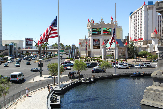 Flags at half-staff are seen in honor of Kirk Kerkorian, one of the founders of modern Las Vegas, outside of the New York-New York hotel-casino in Las Vegas on Tuesday, June 16, 2015. (Chase Steve ...