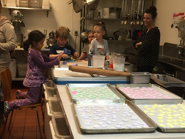 Children work in the kitchen at Chocolate & Spice Bakery, 7293 W. Sahara Ave., Feb. 10 during a Valentine's Day-themed decorating class led by pastry chef and Chocolate & Spice owner Megan Romano. ...