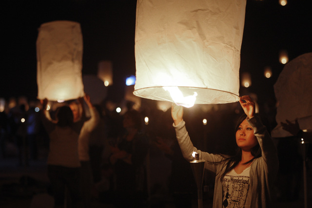 Paper lanterns are filled with hot air at the RiSE Festival Saturday, Oct. 18, 2014 on a dry lake bed near Jean.  (Sam Morris/Las Vegas Review-Journal)