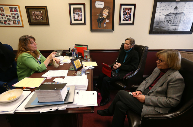 Nevada Assembly Minority Leader Marilyn Kirkpatrick, D-North Las Vegas, talks with Las Vegas Review-Journal reporters Laura Myers, center, and Sandra Chereb at the Legislative Building in Carson C ...