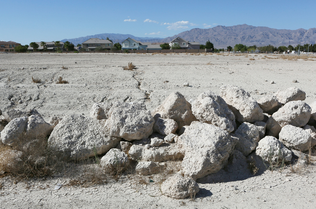An undeveloped parcel of land can be seen at the corner of Centennial Parkway and Tenaya Way near homes Wednesday, May 27, 2015, in Las Vegas. Shiron Development LLC proposed a three-story and 261 ...