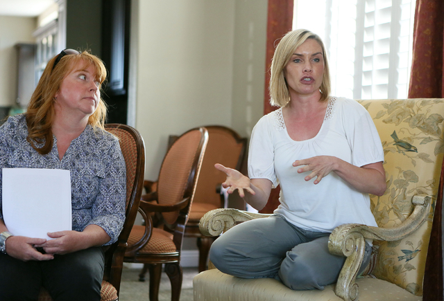 Juliette Berkabile, right, speaks near Patricia G., last name withheld, during a small community gathering in the Berkabile home Wednesday, May 27, 2015, in Las Vegas. The neighbors came together  ...