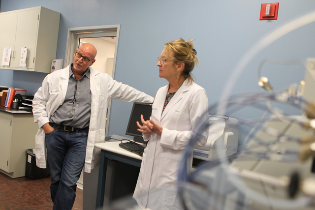 DigiPath Labs employees CEO Todd Denkin, left, with Dr. Cindy Orser, chief science officer, are interviewed during a tour of the DigiPath Labs facility in Las Vegas Wednesday, April 15, 2015. Digi ...