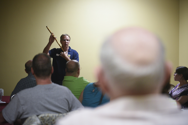 Bob Diamant, Shaolin Kempo instructor with United Studios of Self Defense and guest presenter, demonstrates using a bamboo stick for self defense at the monthly multiple sclerosis support group at ...