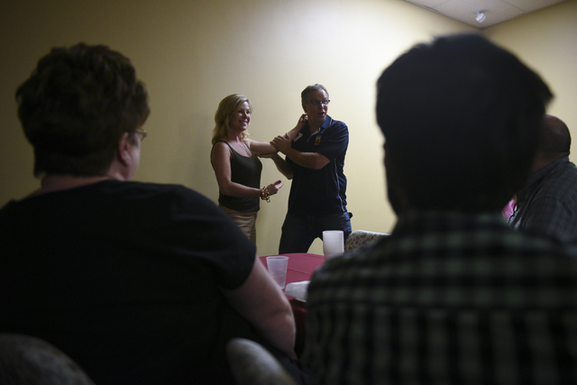 Bob Diamant, Shaolin Kempo instructor with United Studios of Self Defense and guest presenter, right, demonstrates self defense techniques against Gabby Acton, group leader for at the monthly mult ...
