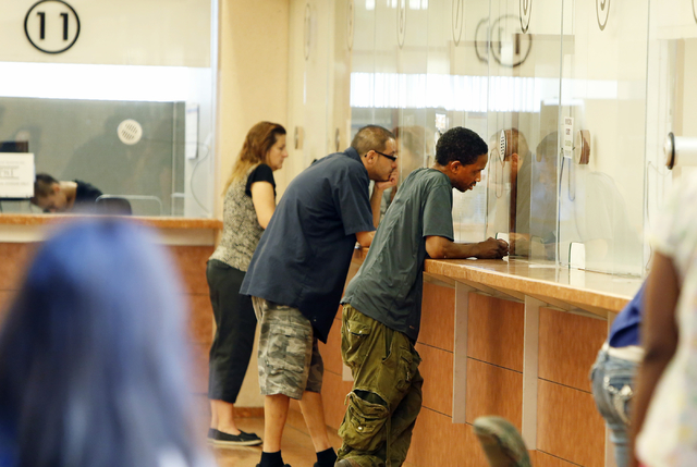 People pay their citations at the Municipal Court payment counter on the first floor of Regional Justice Center on Friday, June 12, 2015. (Bizuayehu Tesfaye/Las Vegas Review-Journal) Follow Bizu T ...