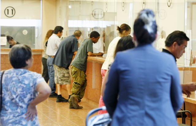 People pay their citations at the counter as other enter the Municipal Court payment center on the first floor of Regional Justice Center on Friday, June 12, 2015. (Bizuayehu Tesfaye/Las Vegas Rev ...