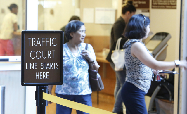 People exit the Municipal Court payment center on the first floor of Regional Justice Center on Friday, June 12, 2015.  (Bizuayehu Tesfaye/Las Vegas Review-Journal) Follow Bizu Tesfaye on Twitter  ...