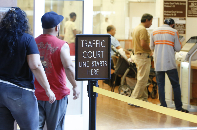 People pay their citations at the counter as others enter the Municipal Court payment center on the first floor of Regional Justice Center on Friday, June 12, 2015. (Bizuayehu Tesfaye/Las Vegas Re ...