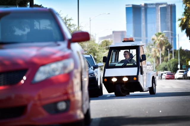 Parking enforcement officer Joshua Kuykendall patrols along 7th Street in downtown Las Vegas on Friday, June 12, 2015. (David Becker/Las Vegas Review-Journal)