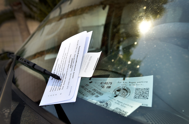 A parking citation for an expired meter is displayed on a vehicle parked along 6th Street in downtown Las Vegas on Friday, June 12, 2015. (David Becker/Las Vegas Review-Journal)