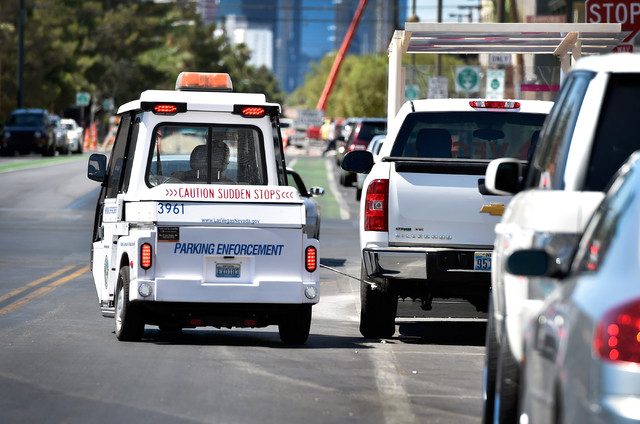Parking enforcement officer Joshua Kuykendall chalks a vehicle's tire as he patrols along 6th Street in downtown Las Vegas on Friday, June 12, 2015. (David Becker/Las Vegas Review-Journal)