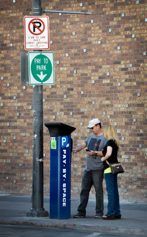 Motorists pay to park along 6th Street in downtown Las Vegas on Friday, June 12, 2015. (David Becker/Las Vegas Review-Journal)