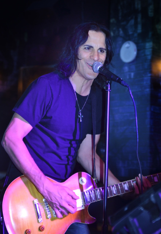 House band guitarist Jimmy Oleson (cq) sings during Rockstar Karaoke in the Rockhouse at the Palazzo hotel-casino at 3355 Las Vegas Blvd. S. in Las Vegas on Tuesday, May 26, 2015. For Rockstar Kar ...