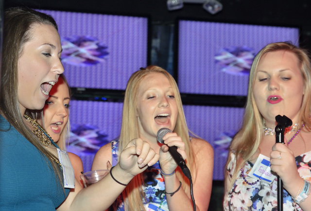Arielle Rodriguez, left, Claire Durkin, second from left, Taylor Swalm (cq), center, and Chore Ellis sing during Rockstar Karaoke in the Rockhouse at the Palazzo hotel-casino at 3355 Las Vegas Blv ...