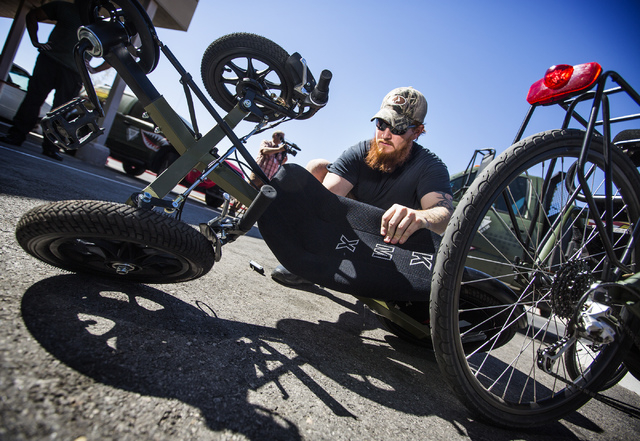 Volunteer Mike Betts adjusts a tricycle at Forgotten Not Gone, 3355 Clayton Street, on Monday, June 22, 2015. The nonprofit  provides trikes for veterans and their families to  reengage with socie ...