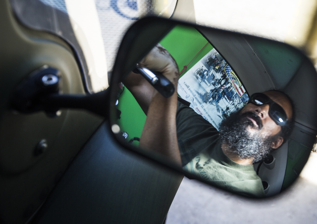 Peter Guidry, co-founder of  Forgotten Not Gone, 3355 Clayton Street, sits inside an enclosed tricycle on Monday, June 22, 2015. The nonprofit  provides trikes for veterans and their families to   ...