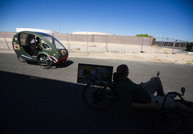 Forgotten Not Gone volunteers goes for a ride on Monday, June 22, 2015. The nonprofit  provides trikes for veterans and their families to  reengage with society through exercise. Follow Jeff Schei ...