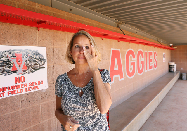 Arbor View High School Assistant Principal Denise Tomchek is overcome with emotion while speaking about her friend and colleague former principal Pat Hayden while standing in the Pat Hayden Field  ...
