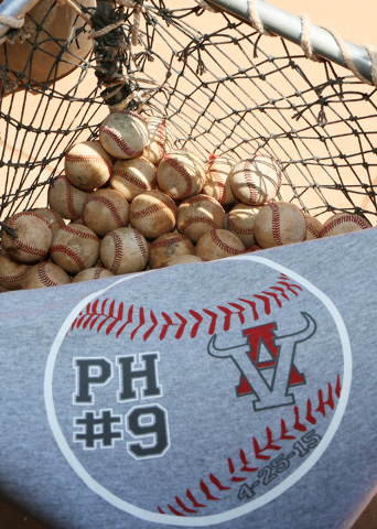 A baseball shirt honoring former principal Pat Hayden is photographed near baseballs in the Pat Hayden Field dugout at Arbor View High School Wednesday, June 17, 2015, in Las Vegas. Arbor View bas ...